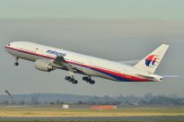 This is the widely released photo of the MH370 plane, on takeoff from Roissy-Charles de Gaulle Airport in 2011. Photo by Laurent Errera.