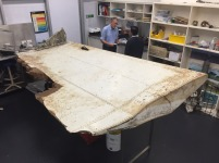 Investigators examine piece of aircraft debris. Source: ATSB