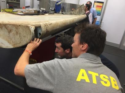 Investigators examine piece of aircraft debris. Source: ATSB