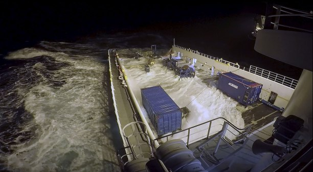 GO Phoenix experiences rough sea conditions in the southern Indian Ocean. The two blue shipping containers on the deck serve as portable workspaces, in which members of the search team conduct towfish operations and maintenance. Source: Hydrospheric Solutions Inc, image by Ryan Galloway & Joshua Phillips.