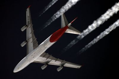 In this undated photo, a Qantas Boeing 747-400 is seen flying over Moscow at an altitude of about 36,000 feet. Source: Sergey Kustov, Airliners.net