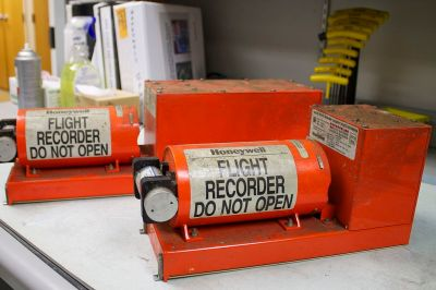 The flight data recorder [left] and cockpit voice recorder [right] of Asiana Airlines flight 214 is seen at NTSB's Washington lab. Flight 214 crashed in July 2011 on final approach to San Francisco. Source: NTSB